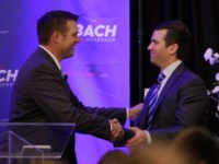 Donald Trump Jr., right, and Kansas Secretary of State Kris Kobach shake hands during a fundraiser for Kobach's campaign for governor Tuesday, Nov. 28, 2017, in Overland Park, Kan. (AP Photo/Charlie Riedel)