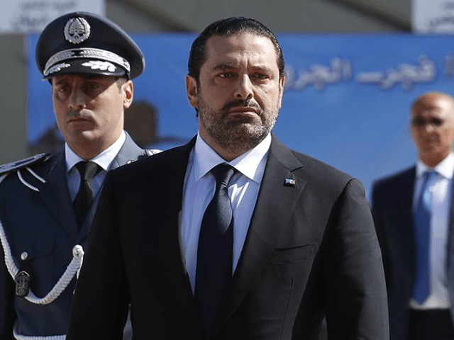 "In this photo taken on Friday, Sept. 8, 2017, Lebanese Prime Minister Saad Hariri, left, arrives for a mass funeral of ten Lebanese soldiers at the Lebanese Defense Ministry, in Yarzeh near Beirut, Lebanon. Lebanese prime minister Saad Hariri has announced he is resigning in a surprise move following a trip to Saudi Arabia. In a televised address Saturday, Nov. 4, he slammed Iran and the Lebanese Hezbollah group for meddling in Arab affairs and says ""Iran's arms in the region will be cut off."" (AP Photo/Hassan Ammar)"