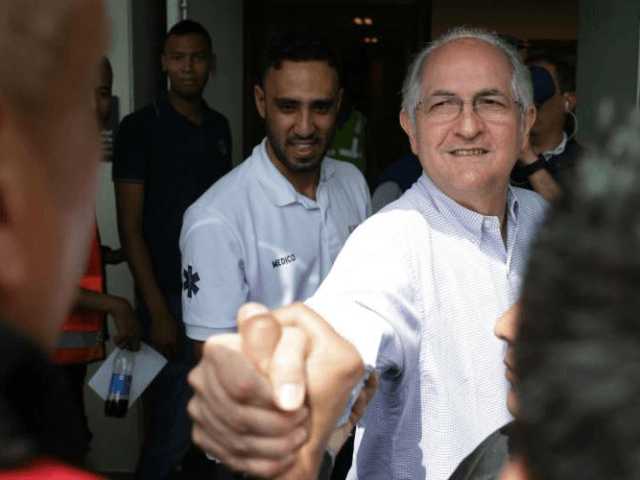 Ousted Caracas Mayor Antonio Ledezma greets a journalist before boarding a plane at El Dorado airport in Bogota, Colombia, Friday, Nov. 17, 2017. Ledezma, who was removed as mayor of Caracas and detained in 2015 on charges of plotting to oust President Nicolas Maduro, escaped house arrest and fled to …