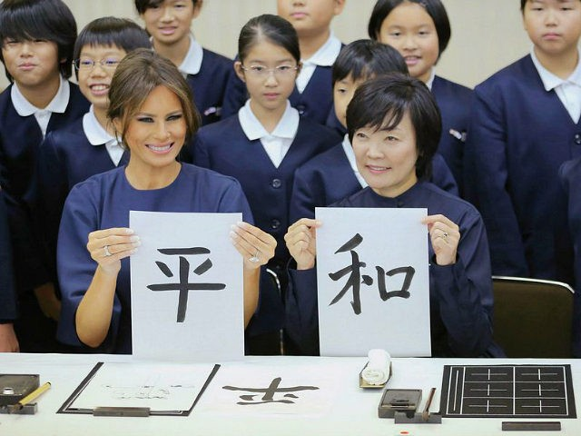 TOKYO, JAPAN - NOVEMBER 06: (CHINA OUT, SOUTH KOREA OUT) Melania Trump, wife of U.S. President Donald Trump, and Akie Abe, wife of Japanese Prime Minister Shinzo Abe show their calligraphy read 'Peace' during the visit to Kyobashi Tsukiji Elementary School on November 6, 2017 in Tokyo, Japan. Trump is on 11-day tour to Asia. (Photo by The Asahi Shimbun via Getty Images)