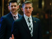 "FILE - In this Nov. 17, 2016 file photo, Retired Lt. Gen Michael Flynn talks to media as he arrives with is son Michael G. Flynn, left, at Trump Tower in New York. Michael G. Flynn tweeted about the false idea that prompted a shooting at a Washington, D.C., pizza parlor. Vice President-elect Mike Pence acknowledged Tuesday, Dec. 6, that the younger Flynn was helping his father with scheduling and administrative items during the presidential transition but told CNN ""that's no longer the case."" (AP Photo/Carolyn Kaster, File)"