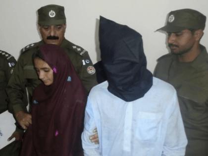 Aasia Bibi, 21, and her boyfriend, Shahid Lashari, are presented to journalists, at a police station in Muzaffargarh, Pakistan, on Monday. (Iram Asim/AP)