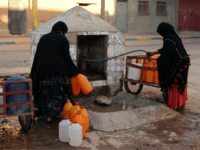 A Thursday Oct. 19, 2017 file photo of Moroccan women filling up containers with water from a hose, in Zagora, southeastern Morocco. Experts blame poor choices in agriculture, growing populations and climate change for the water shortages in towns like Zagora, which has seen repeated protests for access to clean …