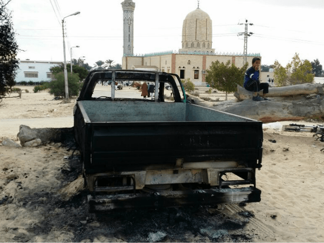 A burned truck is seen outside Al-Rawda Mosque in Bir al-Abd northern Sinai, Egypt a day after attackers killed hundreds of worshippers, on Saturday, Nov. 25, 2017. Friday's assault was Egypt's deadliest attack by Islamic extremists in the country's modern history, a grim milestone in a long-running fight against an insurgency led by a local affiliate of the Islamic State group.(AP Photo/Tarek Samy)