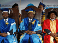 Zimbabwe's President Robert Mugabe, center, sits for formal photographs with university officials, after presiding over a student graduation ceremony at Zimbabwe Open University on the outskirts of Harare, Zimbabwe Friday, Nov. 17, 2017. Mugabe is making his first public appearance since the military put him under house arrest earlier this …