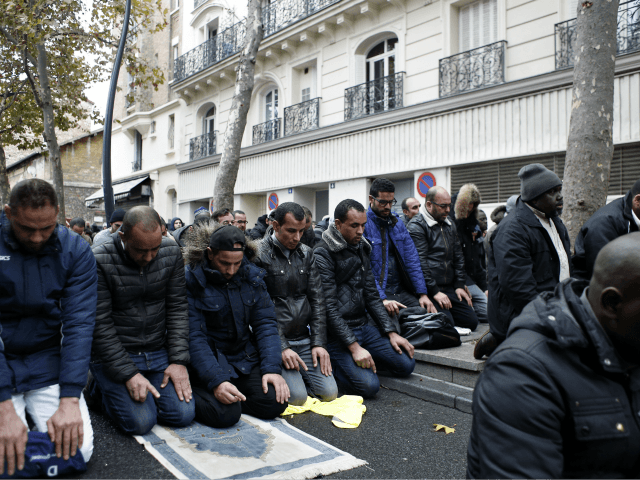 Muslims pray in the street for Friday prayer in the Paris suburb of Clichy la Garenne, Friday, Nov. 10, 2017. Tensions have erupted as residents and the mayor of a Paris suburb tried to block the town's Muslims from praying in the street in a dispute that reflects nationwide problems …