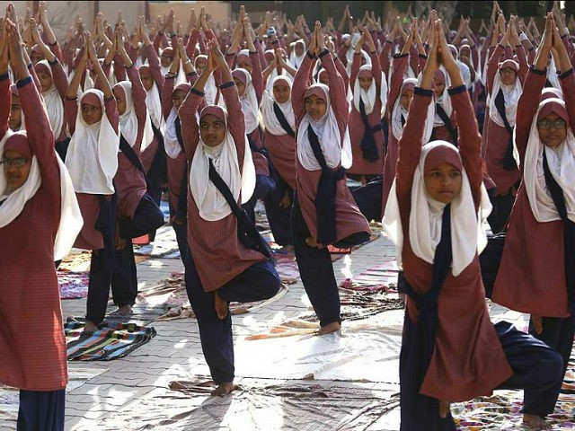 Indian Muslim students practice yoga ahead of International Yoga Day celebrations, at a school in Ahmadabad, India, Saturday, June 17, 2017. International Yoga Day will be celebrated on June 21. (AP Photo/Ajit Solanki)