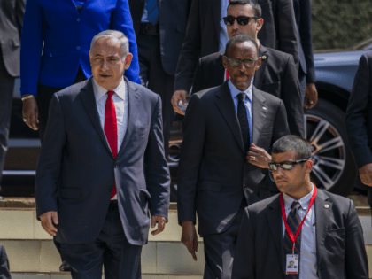 Israeli Prime Minister Benjamin Netanyahu, left, and Rwandas President, Paul Kagame , right, arriving at the Kigali Memorial Center, Kigali, Rwanda, Wednesday, July 6, 2016. Netanyahu is on a one day visit to Rwanda during a four-nation Africa tour.( AP Photo)