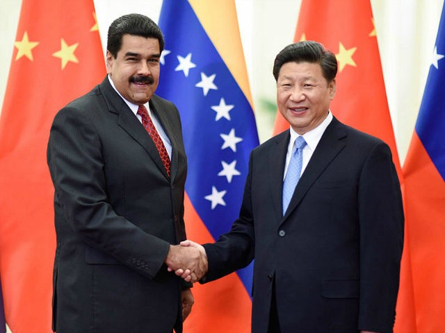 BEIJING, Sept. 1, 2015-- Chinese President Xi Jinping, right, meets with Venezuelan President Nicolas Maduro in Beijing, capital of China, Sept. 1, 2015. (Xinhua/Li Xueren via Getty Images)