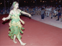 """Palestinian belly dancer Saida, 13, performs at the Zahret al-Mada en, or """"Flower of Cities,"""" nightclub located on the sandy beach in Gaza City in this October 1996 picture. Every weekend, young men, some with guns and cellular phones on their hips, saunter into Gaza s first and only nightclub to drink cheap Israeli whiskey and ogle sultry singers and belly dancers gyrating to Arabic love songs. But to most Gazans, the club is an eyesore - and not simply because it offends a deeply conservative society that still winces at the sight of a woman in a sleeveless blouse. (AP Photo/Adel Hana)"""