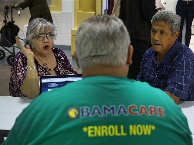 MIAMI, FL - NOVEMBER 01: Isabel Diaz Tinoco (L) and Jose Luis Tinoco speak with Otto Hernandez, an insurance agent from Sunshine Life and Health Advisors, as they shop for insurance under the Affordable Care Act at a store setup in the Mall of Americas on November 1, 2017 in …