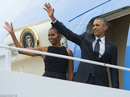 US President Barack Obama and First Lady Michelle Obama wave from Air Force One prior to departing from Andrews Air Force Base in Maryland, August 7, 2015. The Obamas are traveling to Martha's Vineyard, Massachusetts, for a 2-week vacation. AFP PHOTO / SAUL LOEB (Photo credit should read SAUL LOEB/AFP/Getty …