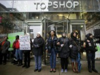 Demonstrators block the entrance of Top Shop as they protest the shooting of Laquan McDonald along the Magnificent Mile November 27, 2015 in Chicago, Illinois. Chicago police officer Jason Van Dyke was charged Tuesday with first degree murder for fatally shooting 17-year-old McDonald 16 times last year on the southwest side of Chicago after Van Dyke was responding to a call of a knife wielding man. The dash-cam video of officer Van Dyke shooting McDonald was released by the Chicago Police department earlier this week after a judge denied Van Dyke bail during his bond hearing at Leighton Criminal Court. (Photo by Joshua Lott/Getty Images)