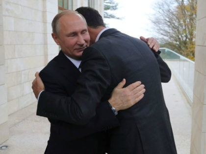 Russia's President Vladimir Putin (L) embraces his Syrian counterpart Bashar al-Assad during a meeting in Sochi on November 20, 2017. / AFP PHOTO / SPUTNIK / Mikhail KLIMENTYEV (Photo credit should read MIKHAIL KLIMENTYEV/AFP/Getty Images)