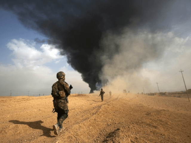 Iraqi forces advance towards the town of Al-Qaim near the Syrian border as they fight to capture the last holdouts of the Islamic State group in the country on November 3, 2017