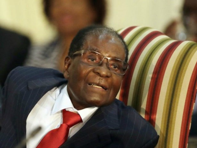 FILE - In this file photo dated Tuesday, Oct. 3, 2017, Zimbabwe's President Robert Mugabe, during his meeting with South African President Jacob Zuma, at the Presidential Guesthouse in Pretoria, South Africa. Zimbabwe President Robert Mugabe has long faced United States sanctions over his government's human rights abuses, but the …