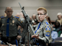 FILE - In this Jan. 28, 2013, file photo, firearms training unit Detective Barbara J. Mattson, of the Connecticut State Police, holds up a Bushmaster AR-15 rifle, the same make and model of gun used by Adam Lanza in the Sandy Hook School shooting, for a demonstration during a hearing …