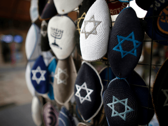Jewish Kippas (skullcaps) are seen on display at a store in downtown west Jerusalem, on January 15, 2016. Israeli Prime Minister Benjamin Netanyahu, on January 14, addressed the situation of French Jews, by saying 'at the same time every Jew should know that they have a home in Israel and that's a choice that each one of them then makes,' in response to a string of anti-Semitic events in recent months that brought Marseille's top Jewish leader to call on men and boys to stop wearing a kippa. / AFP / THOMAS COEX (Photo credit should read THOMAS COEX/AFP/Getty Images)