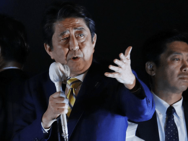 Japan's Prime Minister and President of the ruling Liberal Democratic Party Shinzo Abe delivers a speech to the crowd in support for his party's candidate during an election campaign for the upcoming lower house election in Tokyo. Media polls indicate Abe's ruling coalition will easily win a general election Sunday, …