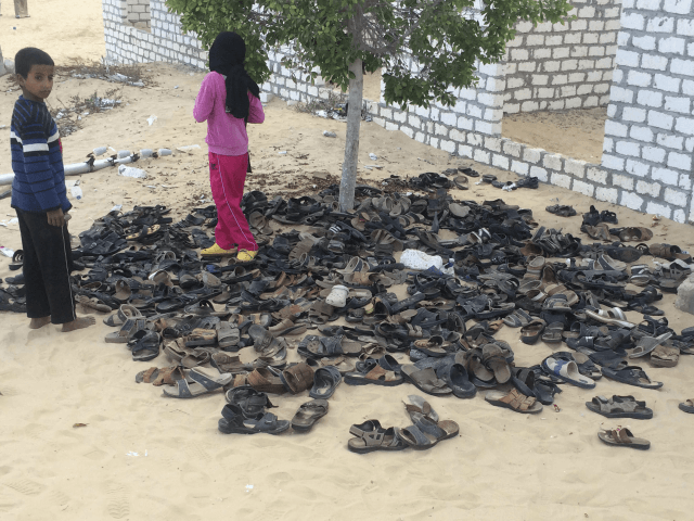 Discarded shoes of victims remain outside Al-Rawda Mosque in Bir al-Abd northern Sinai, Egypt. a day after attackers killed hundreds of worshippers, on Saturday, Nov. 25, 2017. Friday's assault was Egypt's deadliest attack by Islamic extremists in the country's modern history, a grim milestone in a long-running fight against an …