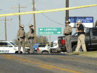 SUTHERLAND SPRINGS, TX - NOVEMBER 5: Law enforcement officials gather near First Baptist Church following a shooting on November 5, 2017 in Sutherland Springs, Texas. At least 26 people were reportedly killed and 24 injured when a gunman, identified as Devin P. Kelley, 26, allegedly entered the church during a …