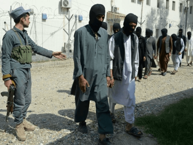 Afghan security forces escort suspected Islamic State and Taliban fighters at police headquarters in Jalalabad. The alleged torture or mistreatment of prisoners being one of the possible war crimes the ICC wants to investigate.