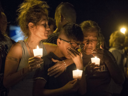 Mona Rodriguez holds her 12-year-old son, J Anthony Hernandez, during a candlelight vigil held for the victims of a fatal shooting at the First Baptist Church of Sutherland Springs, Sunday, Nov. 5, 2017, in Sutherland Springs, Texas. (Nick Wagner/Austin American-Statesman via AP)
