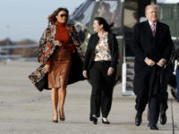 First lady Melania Trump, left, walks with President Donald Trump, as they board Air Force One, as they depart Tuesday, Nov. 21, 2017, at Andrews Air Force Base, Md. Trump is en route to his Mar-a-Largo resort in Florida for the Thanksgiving holiday. (AP Photo/Alex Brandon)