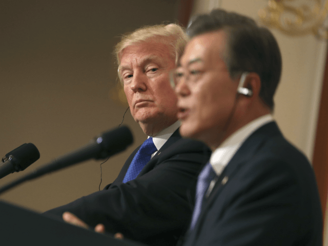 "President Donald Trump, left, listens to South Korean President Moon Jae-in during a joint news conference at the Blue House in Seoul, South Korea, Tuesday, Nov. 7, 2017. President Donald Trump, on his first day on the Korean peninsula, signaled a willingness to negotiate with North Korea to end its nuclear weapons program, urging Pyongyang to ""come to the table"" and ""make a deal."" (AP Photo/Andrew Harnik)"