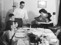 circa 1955: A Thanksgiving turkey comes to the table watched by the family. (Photo by Evans/Three Lions/Getty Images)