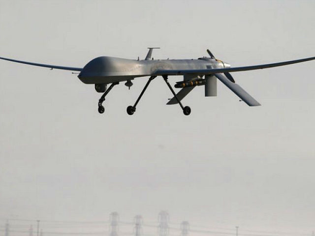 UNSPECIFIED, UNSPECIFIED - JANUARY 07: A U.S. Air Force MQ-1B Predator unmanned aerial vehicle (UAV), carrying a Hellfire missile lands at a secret air base after flying a mission in the Persian Gulf region on January 7, 2016. The U.S. military and coalition forces use the base, located in an …