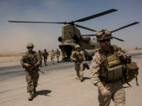 CAMP BOST, AFGHANISTAN - SEPTEMBER 11: U.S. service members walk off a helicopter on the runway at Camp Bost on September 11, 2017 in Helmand Province, Afghanistan. About 300 marines are currently deployed in Helmand Province in a train, advise, and assist role supporting local Afghan security forces. Currently the United States has about 11,000 troops in the deployed in Afghanistan, with a reported 4,000 more expected to arrive in the coming weeks. Last month, President Donald Trump announced his plan for Afghanistan which called for an increase in troop numbers and a new conditions-based approach to the war, getting rid of a timetable for the withdrawal of American forces in the country. (Photo by Andrew Renneisen/Getty Images)