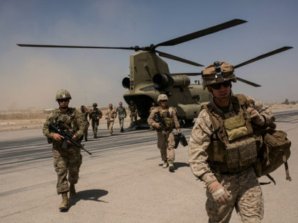 CAMP BOST, AFGHANISTAN - SEPTEMBER 11: U.S. service members walk off a helicopter on the runway at Camp Bost on September 11, 2017 in Helmand Province, Afghanistan. About 300 marines are currently deployed in Helmand Province in a train, advise, and assist role supporting local Afghan security forces. Currently the …