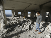 A Palestinian man inspects apartment of Nimr Jamal after it was demolished by the Israeli army in the West Bank village of Beit Surik near Jerusalem, Wednesday, Nov. 15, 2017. Jamal killed the three Israelis and critically wounded a fourth outside the West Bank settlement of Har Adar before he was shot dead past September. (AP Photo/Majdi Mohammed)