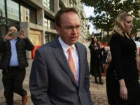 WASHINGTON, DC - NOVEMBER 27: White House Budget Director Mick Mulvaney, President Donald Trump's pick for acting director of the Consumer Financial Protection Bureau, walks back to the White House from the CFPB building after he showed up for his first day of work on November 27, 2017 in Washington, …