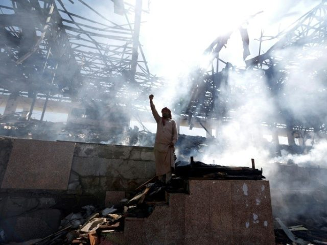 A Yemeni man gestures on November 5, 2017 at the site of an air strike in the capital Sanaa, where a Saudi-led coalition has been bombing Iran-backed Shiite rebels