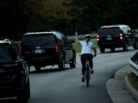 Cyclist who gave Trump the finger loses her job: report