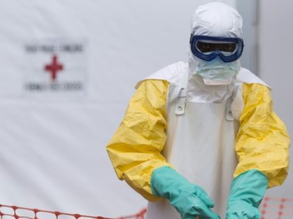 A health worker works at a Red Cross-run Ebola treatment center in Guinea, one of several West African nations where Red Cross officials committed fraud and misappropriated funds earmarked for Ebola relief