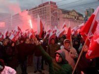 Demonstrators burn flares and wave Polish flags during the annual march to commemorate Poland's National Independence Day in Warsaw organised by far-right nationalists.