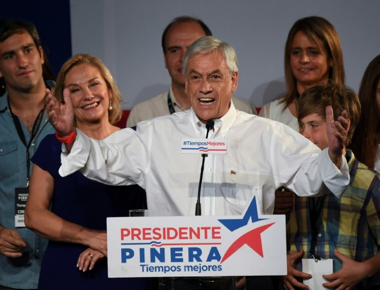 Chilean presidential candidate Sebastian Pinera delivers a speech at the party headquarters in Santiago de Chile