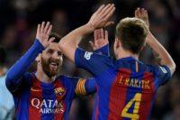 Barcelona's midfielder Ivan Rakitic (R) celebrates with forward Lionel Messi after scoring a goal