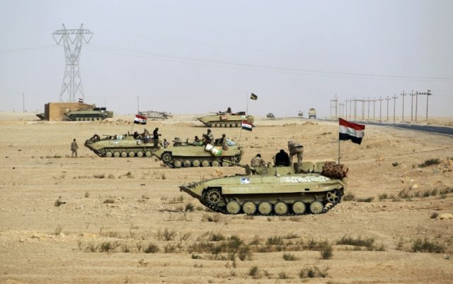 Iraqi tanks advance through the desert towards the town of Al-Qaim on the Syrian border which they recaptured from the Islamic State group on November 3, 2017