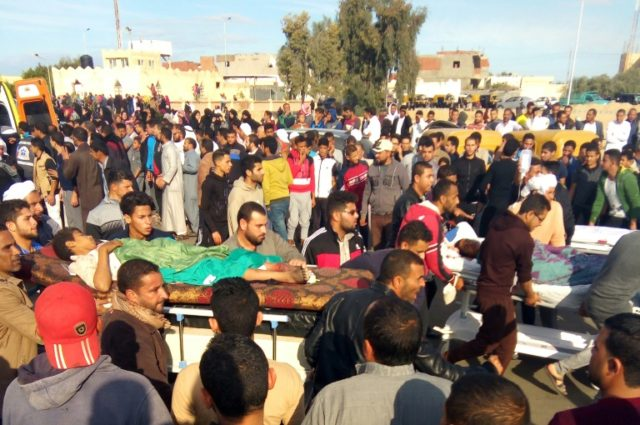 Egyptians carry victims on stretchers following an attack on the Rawda mosque in the Sinai on November 24, 2017