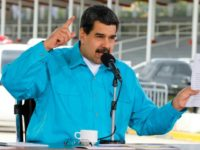 Venezuelan President Nicolas Maduro, seen here in a handout photo speaking during an event in Caracas, says he wants the debt-ridden state oil company restructured and has named a general to lead the effort