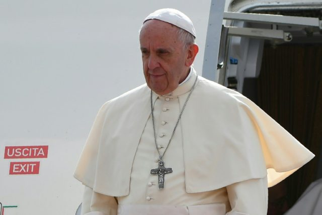 Pope Francis arrived in Myanmar on Monday to a warm welcome from the country's small but enthusiastic Catholic population