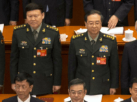 In this March 5, 2017, photo, Zhang Yang, left, the then-head of China's People's Liberation Army (PLA) political affairs department, and Fang Fenghui, right, the then-chief of the general staff of the Chinese People's Liberation Army stand during the opening session of China's National People's Congress (NPC) at the Great …