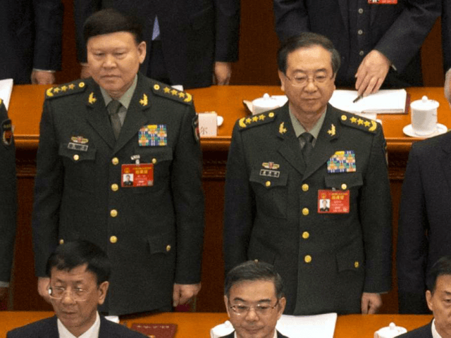In this March 5, 2017, photo, Zhang Yang, left, the then-head of China's People's Liberation Army (PLA) political affairs department, and Fang Fenghui, right, the then-chief of the general staff of the Chinese People's Liberation Army stand during the opening session of China's National People's Congress (NPC) at the Great Hall of the People in Beijing, Sunday, March 5, 2017. Chinese state media said Tuesday, Nov. 28, 2017, that Zhang killed himself Nov. 23 at his home, to which he had been confined while under investigation for major corruption. (AP Photo/Mark Schiefelbein)