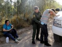 Border Patrol Agents arrest illegal border crossers in South Texas. AP File Photo: Eric Gay