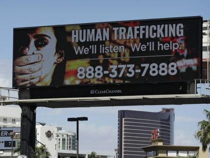 FILE - In this Thursday, Sept. 21, 2017 photo, a billboard displays a phone number for the National Human Trafficking Hotline in Las Vegas. Many Americans know little about the hotline beyond the billboards and other public service ads providing its phone number. Yet people in the anti-trafficking field say …