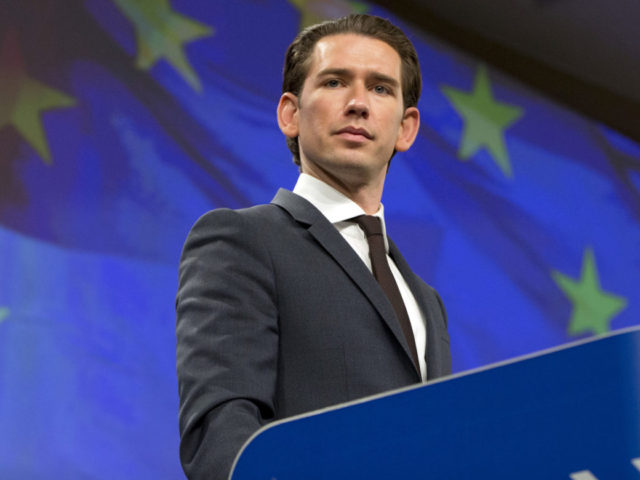 Austrian Chancellor Sebastian Kurz listens to questions during a joint media conference with European Commission President Jean-Claude Juncker at EU headquarters in Brussels on Tuesday, Dec. 19, 2017. (AP Photo/Virginia Mayo)